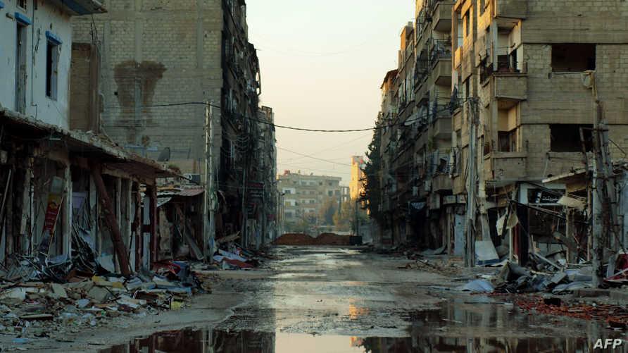 احد شوارع مدينة داريا بضواحي دمشق عقب تعرضها للقصف