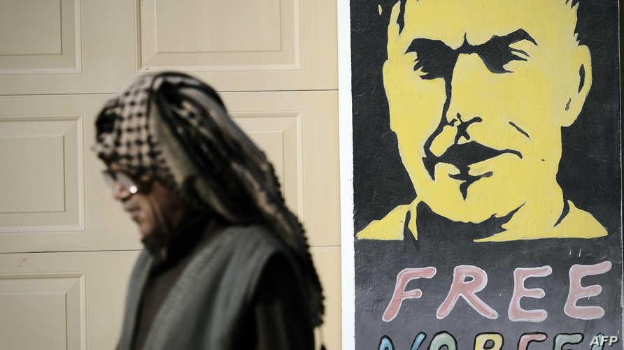 ملصق يطالب بالحرية للمعارض البحريني المعتقل نبيل رجب