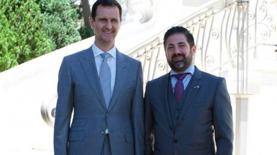 صورة تداولها معارضون سوريون للرملي مع الأسد
