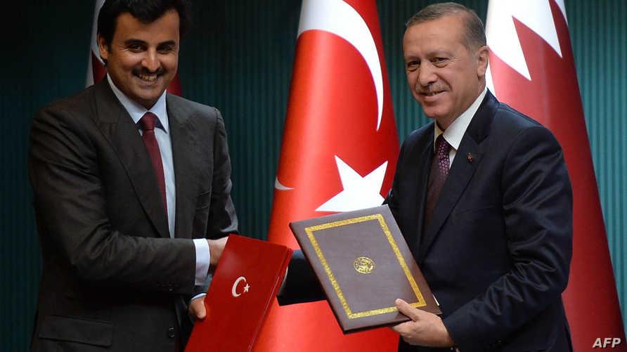 الرئيس التركي رجب طيب أردوغان رفقة أمير القطر تميم بن حمد آل ثاني- أرشيف