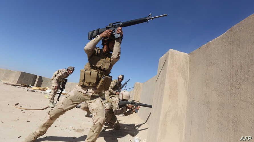 جنود عراقيون خلال مواجهات مع داعش في قضاء الكرمة- أرشيف