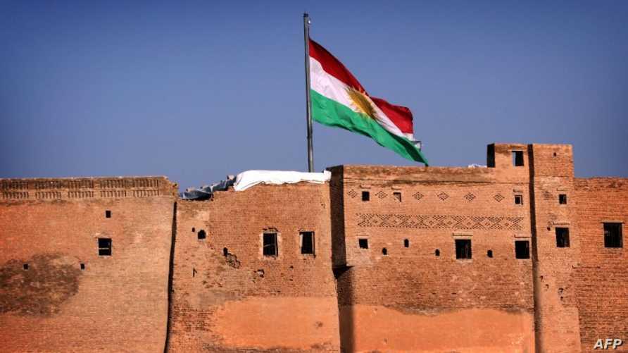 علم إقليم كردستان فوق قلعة أربيل