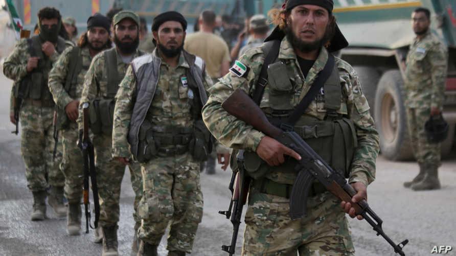 مقاتلون تابعون للجيش الوطني السوري المدعوم من تركيا - 11 أكتوبر 2019
