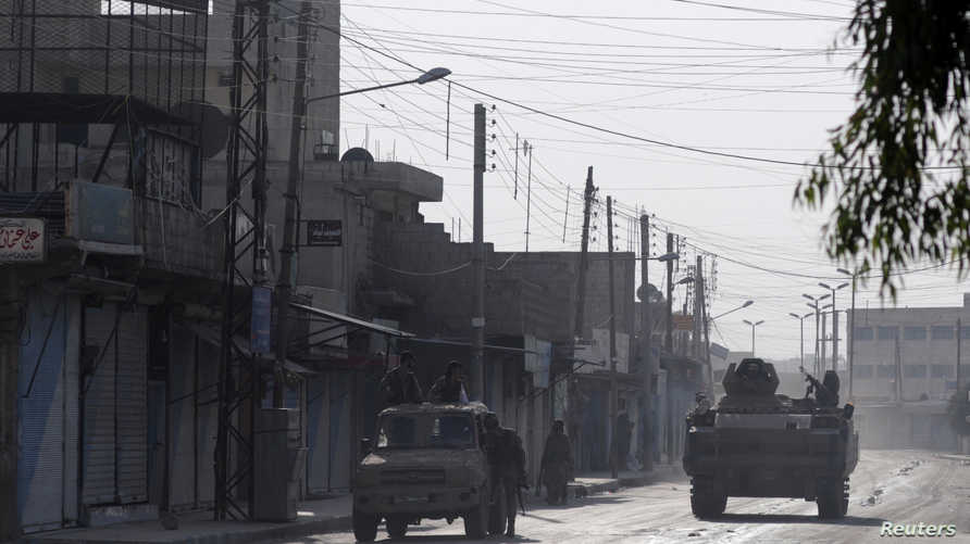 مسلحون سوريون تدعمهم تركيا في تل أبيض