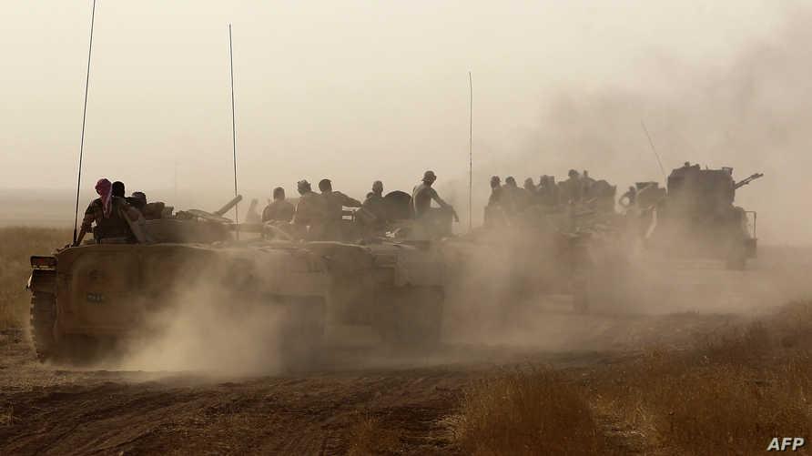 القوات العراقية خلال تقدمها نحو الشرقاط