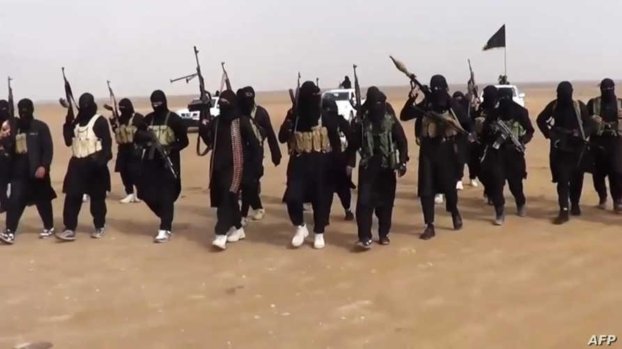 مقاتلو داعش خلال اجتياحهم مدينة تكريت