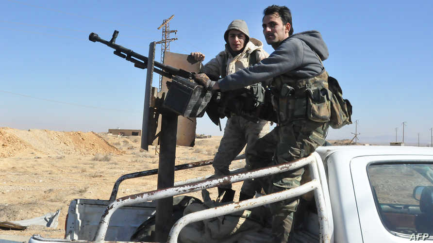 عنصران من القوات السورية في حمص- أرشيف