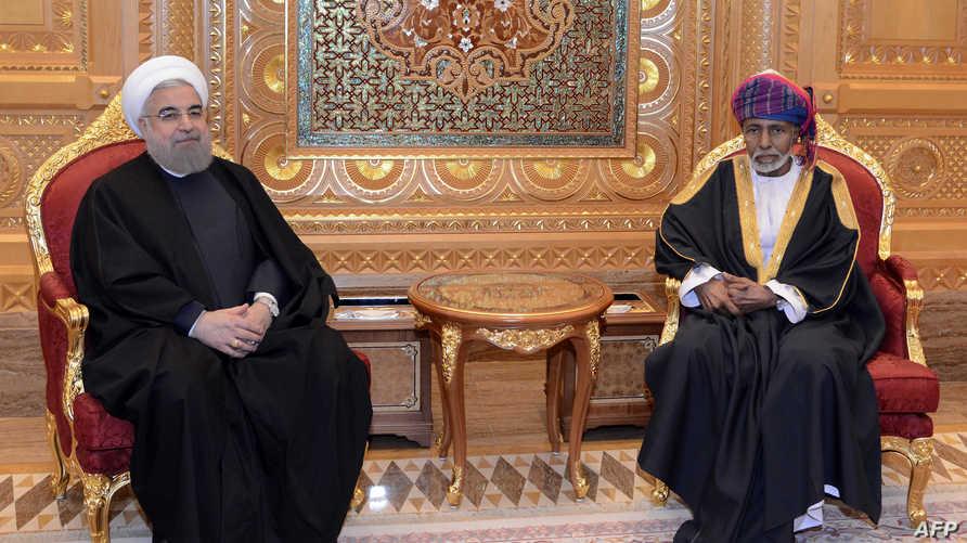 روحاني مع السلطان قابوس في مسقط
