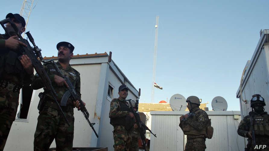 عناصر من الشرطة العراقية عقب هجوم استهدف مركزا أمنيا في الفلوجة-ارشيف