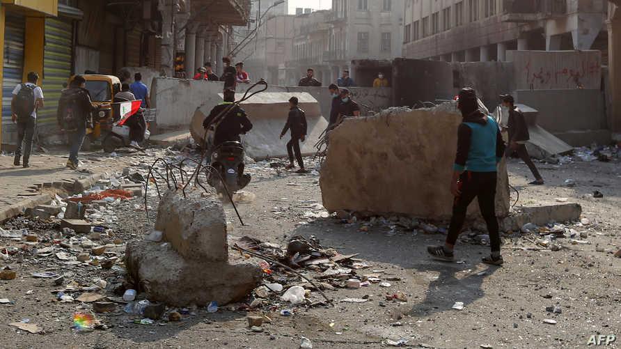 اشتباكات بين المتظاهرين وقوات الأمن العراقية في بغداد 25 نوفمبر 2019