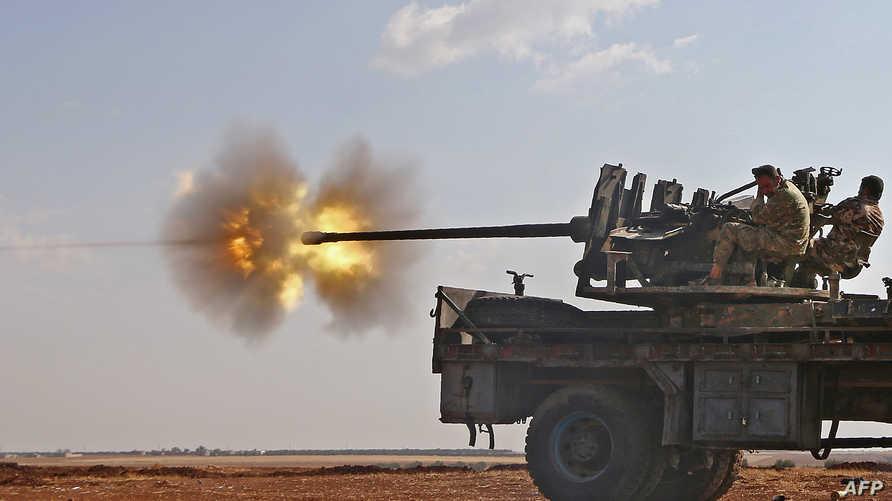 مقاتلون من قوات الجيش السوري الحر خلال معركة دابق