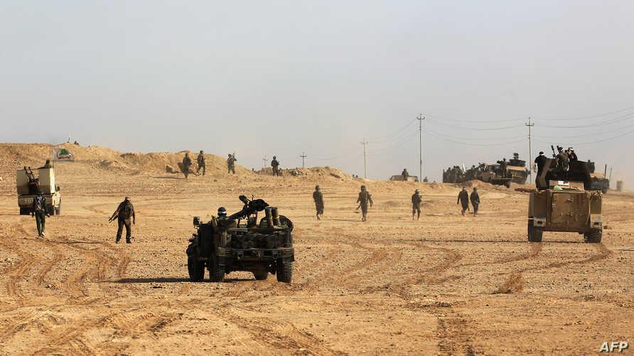 القوات العراقية وعناصر من الحشد الشعبي تتقدم باتجاه القائم