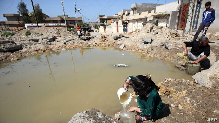 طفلة عراقية في أحد أحياء غرب الموصل