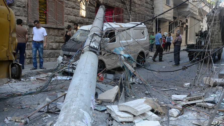 جانب من أحد الأحياء الخاضعة للقوات النظامية في حلب بعد أن استهدفته صواريخ فصائل المعارضة -أرشيف