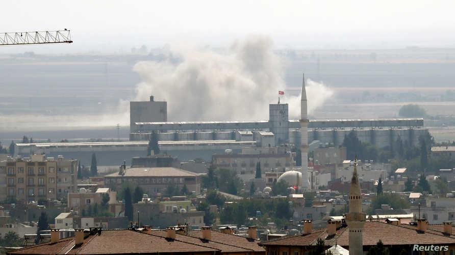 الدخان يتصاعد بعد قصف تركي على مدينة رأس العين في 13 أكتوبر 2019