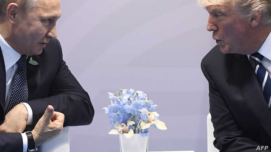 الرئيس دونالد ترامب مع الرئيس الروسي فلاديمير بوتين