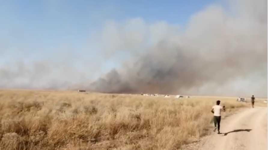 حريق في أحد حقول زراعة الحنطة في العراق