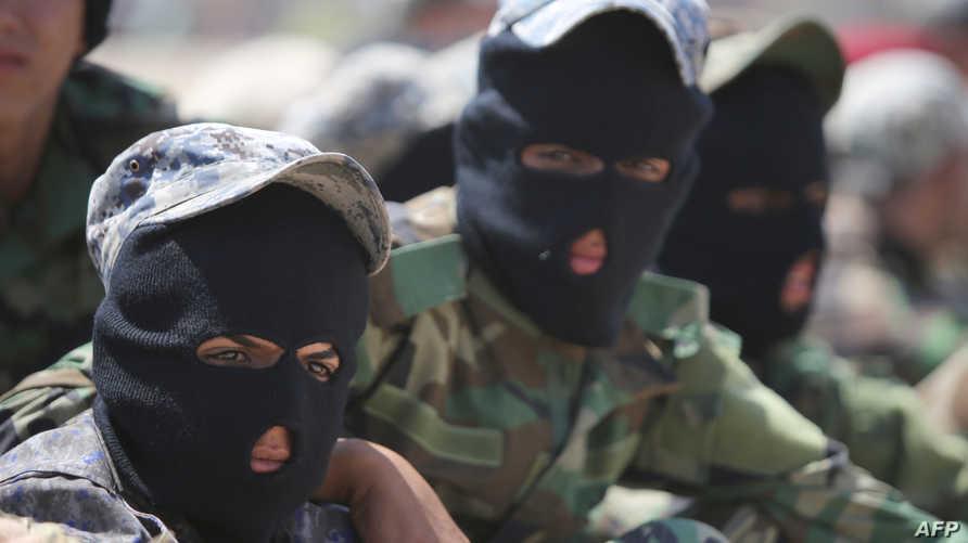 عناصر من ميليشيا كتائب حزب الله العراقي
