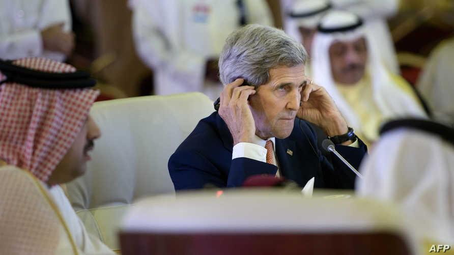 كيري خلال الاجتماع الوزاري في الدوحة