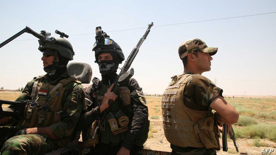 عناصر القوات الأمنية العراقية قرب الرمادي - أرشيف