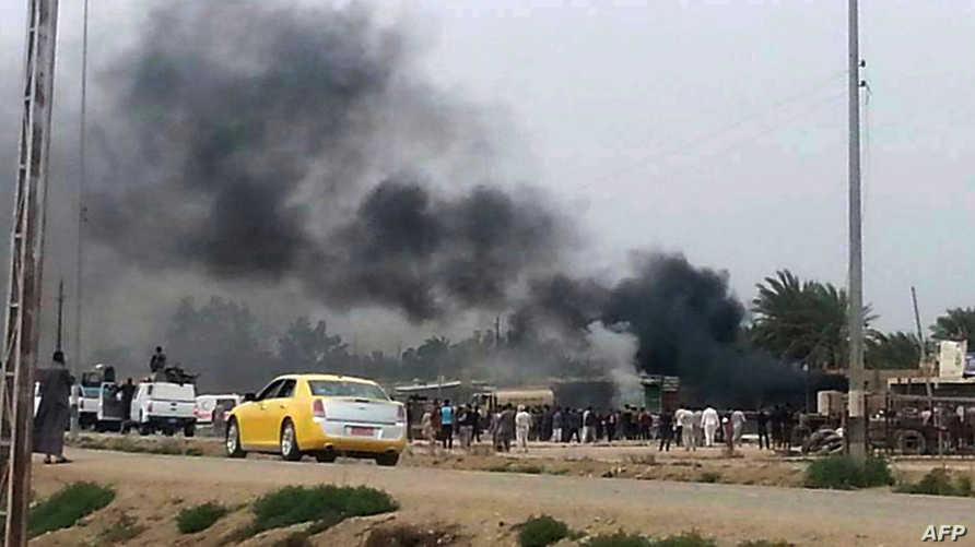 تصاعد دخان عقب تفجير انتحاري جنوب بغداد-أرشيف