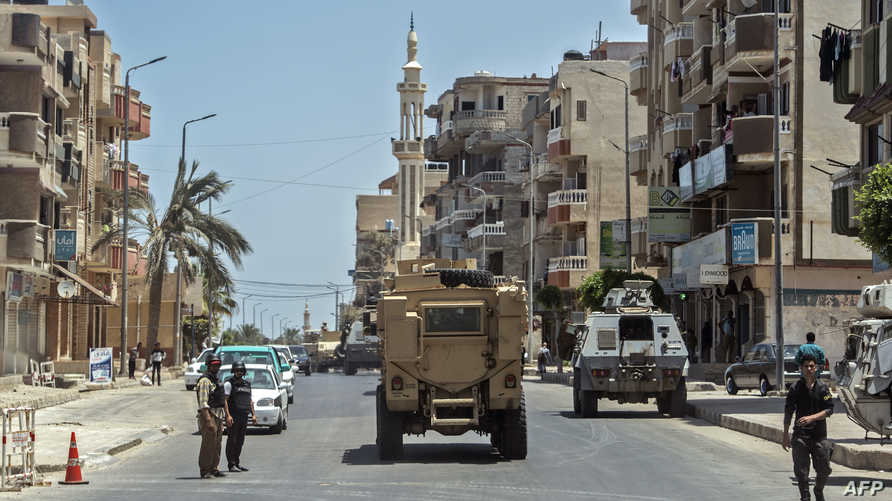 قوات من الجيش والشرطة في مدينة العريش في شمال سيناء في صورة التقطت في 26 يوليو 2018