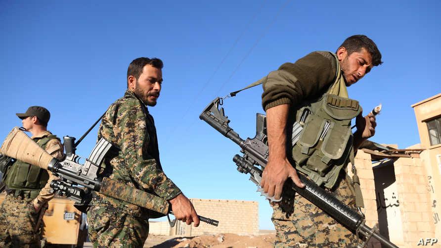 مقاتلون أكراد ضد داعش في سورية