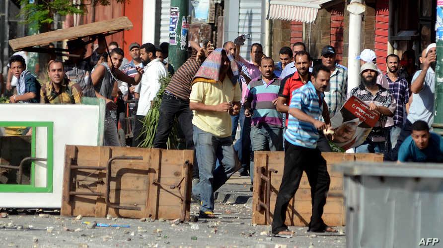 اشتباكات بين مؤيدين للرئيس المصري المعزول محمد مرسي ومعارضين له في الاسكندرية