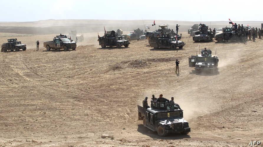 القوات العراقية خلال تقدمها جنوب الموصل
