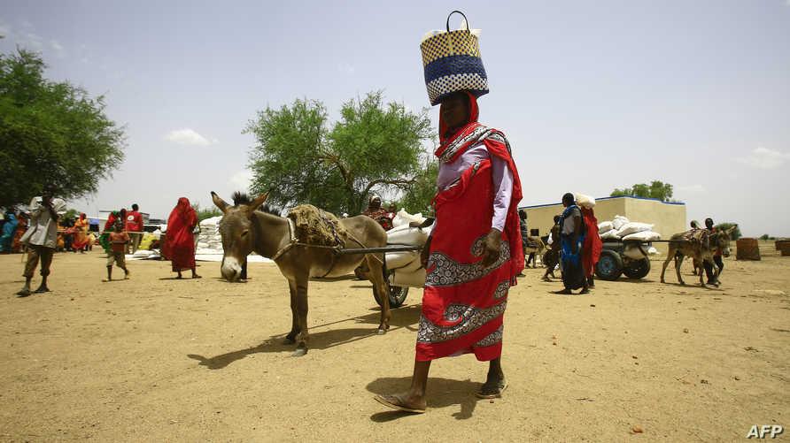 سيدة سودانية في أحد مخيمات النازحين في ولاية كردفان السودانية