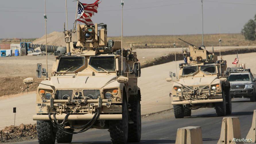 رتل المدرعات العسكرية الأميركية بعدما عبر الحدود السورية العراقية
