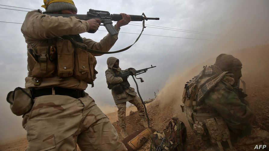 عناصر في الحشد الشعبي خلال مشاركتهم في عملية تحرير الموصل
