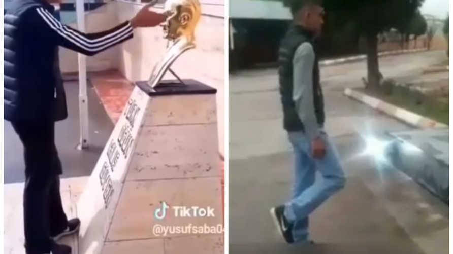 شاب تركي يهين تمثالا لأتاتورك