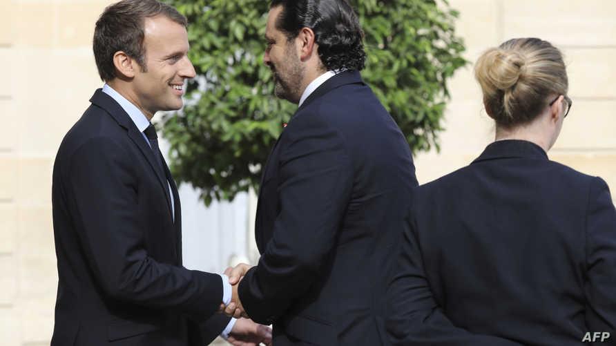 ماكرون والحريري خلال لقاء سابق
