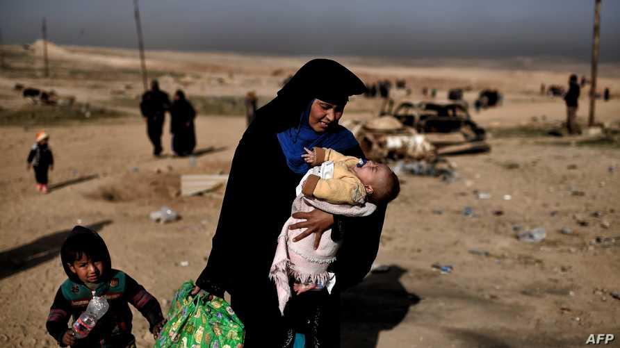عراقية فارة من الموصل