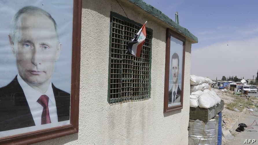 صورة الرئيسين السوري والروسي عند نقطة تفتيش قرب دمشق