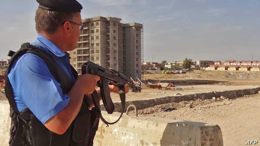 أحد عناصر الشرطة العراقية خلال عملية كركوك