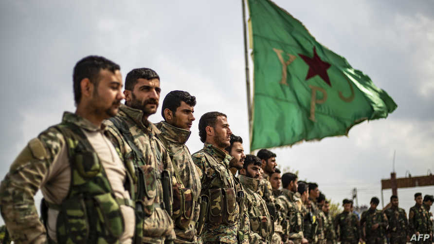 """مقاتلون من """"قوات سوريا الديمقراطية"""""""