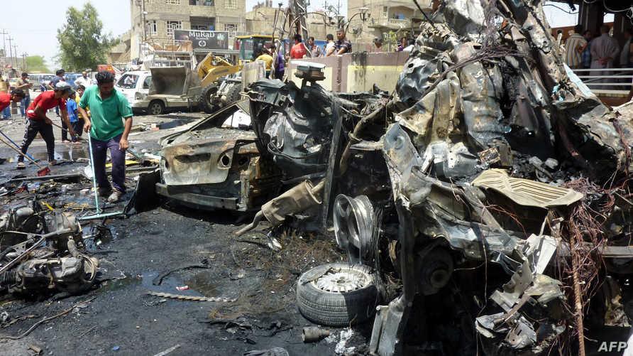 آثار انفجار سيارة ملغومة في مدينة الصدر بمحافظة بغداد- أرشيف