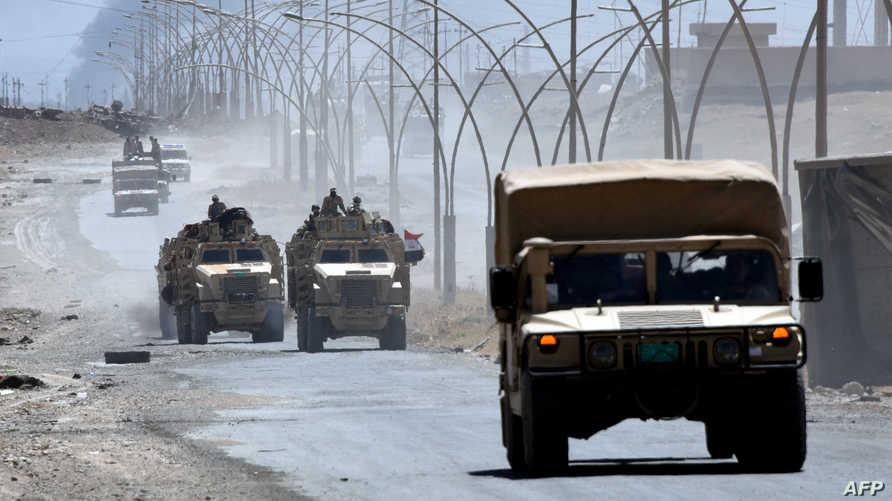 عربات عسكرية عراقية في طريق تؤدي إلى تلعفر- أرشيف