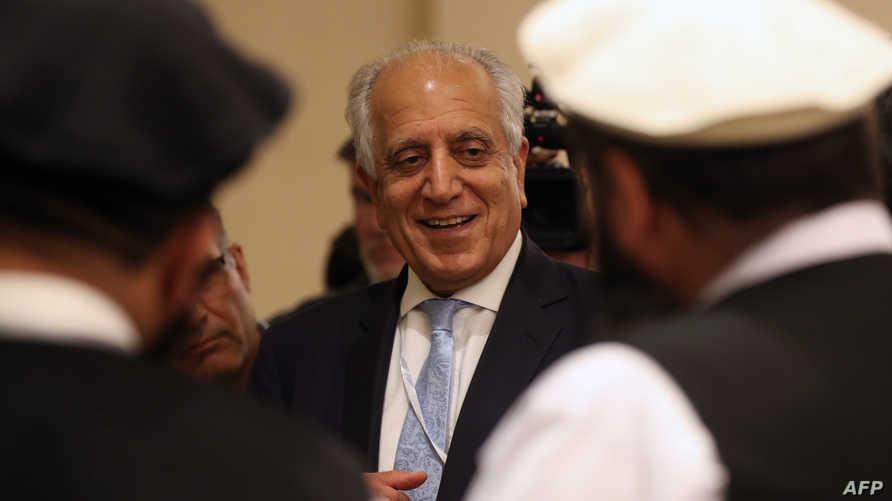 المبعوث الأميركي الخاص زلماي خليل زاد مع ممثلين عن طالبان في الدوحة (يوليو 2019)
