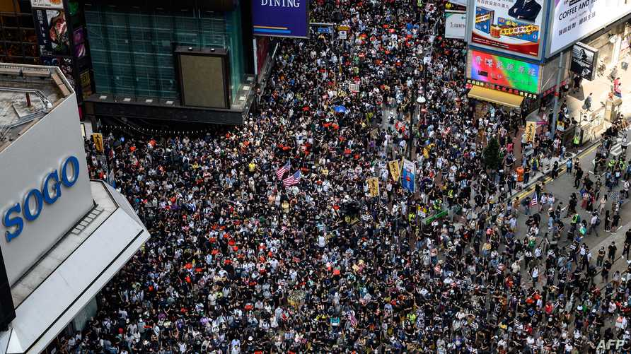 متظاهرون في هونغ كونغ يطالبون بالحرية  ويدعون واشنطن ولندن للتدخل ضد الصين