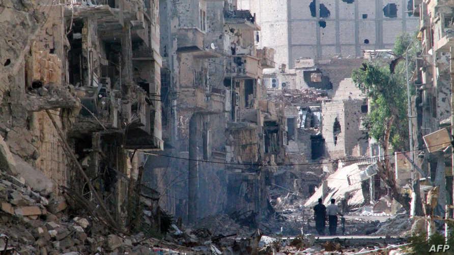 جانب من الدمار الذي لحق بأحياء مدينة دير الزور جراء القصف الجوي