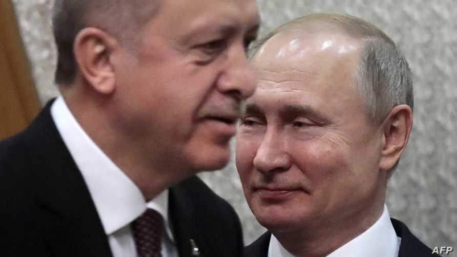 الرئيس الروسي فلاديمير بوتين ومن أمامه الرئيس التركي رجب طيب أردوغان في منتجع سوتشي- 14 فبراير 2019