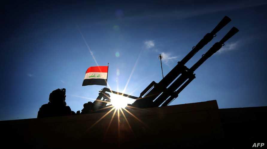 جندي عراقي في مدخل قاعدة عمليات التحرير في مخمور قرب الموصل