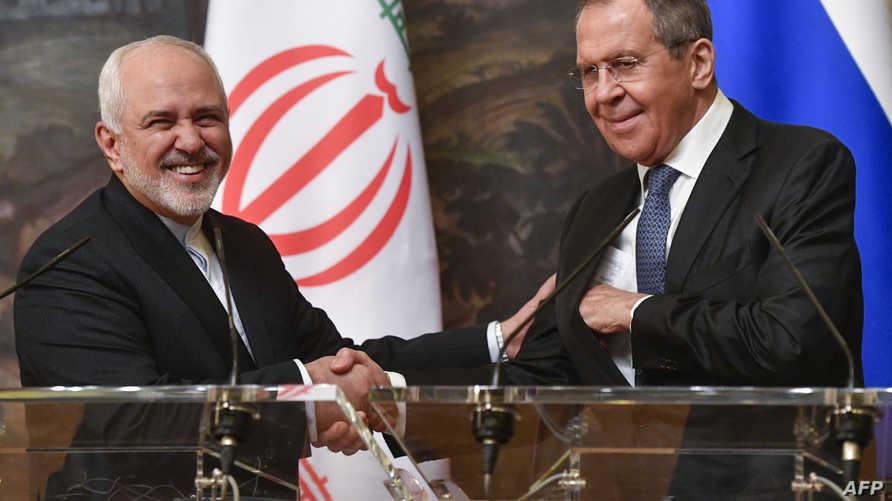 وزير الخارجية الروسي سيرغي لافروف مع نظيره الإيراني جواد ظريف
