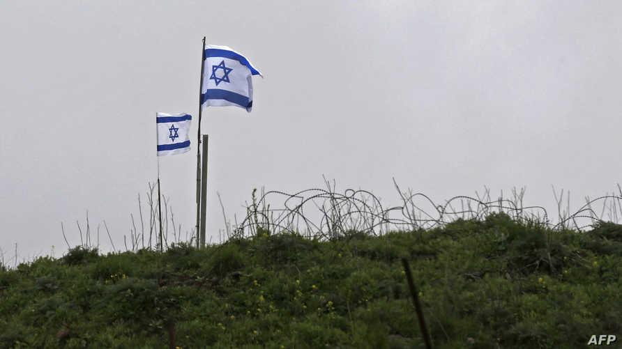 العلم الإسرائيلي في قاعدة قرب الحدود مع سوريا في مرتفعات الجولان