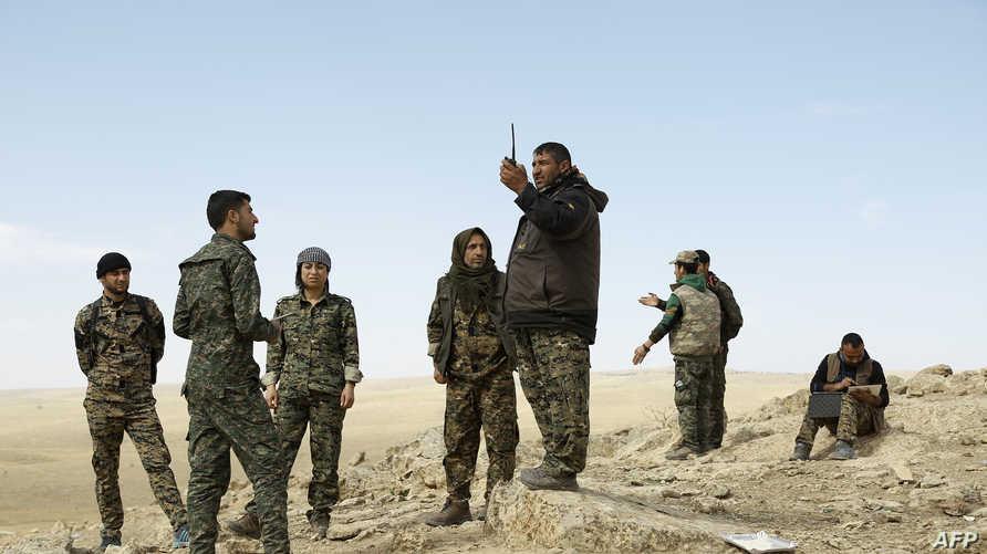 عناصر من قوات سورية الديموقراطية في الحسكة