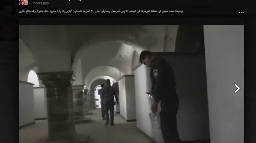 عناصر في الشرطة الاتحادية داخل كنيسة الساعة في الموصل