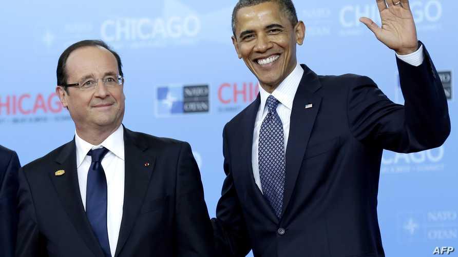 الرئيس باراك أوباما يلتقي نظيره الفرنسي فرانسوا هولاند خلال قمة مجموعة الثماني، أرشيف